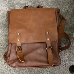 Down faux leather backpack